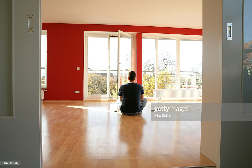 Backview of man sitting in new apartment : Stock Photo