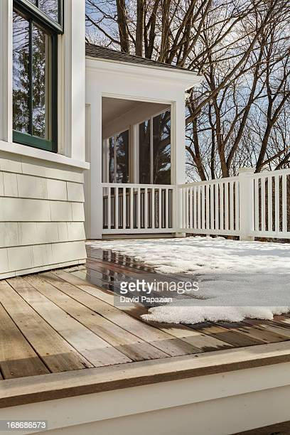 Backyard deck with snow