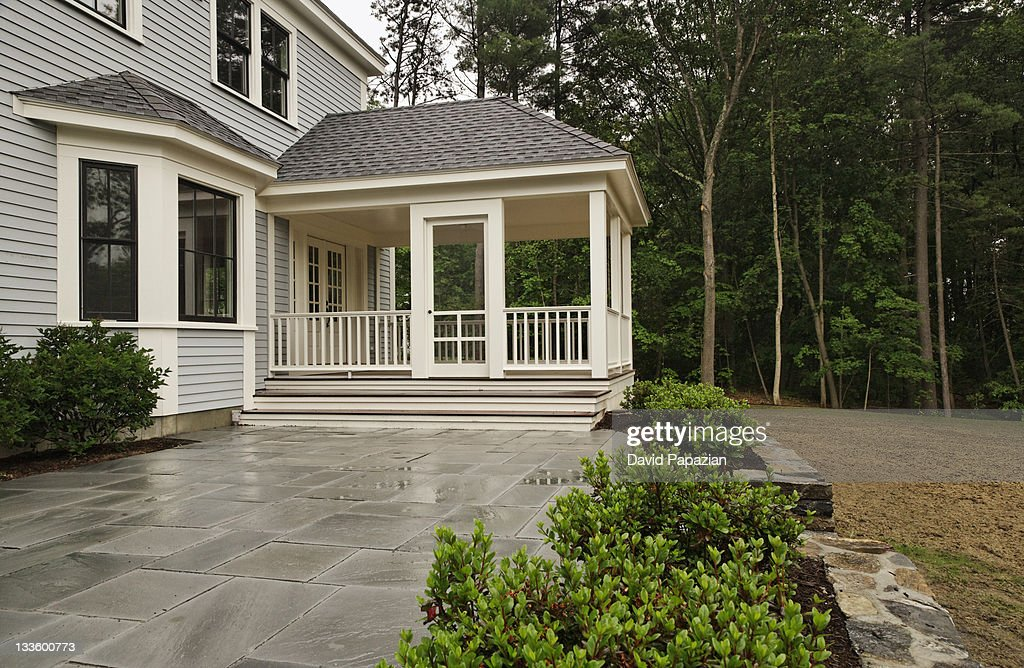 Backyard living space with enclosed back deck : Stock Photo