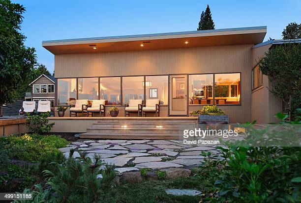 Backyard of contemporary house at twilight