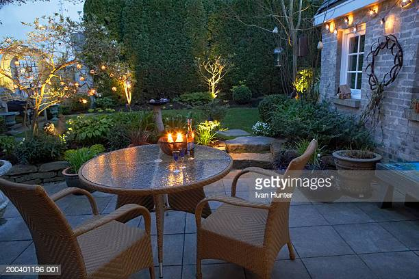 Backyard of house with table and chairs