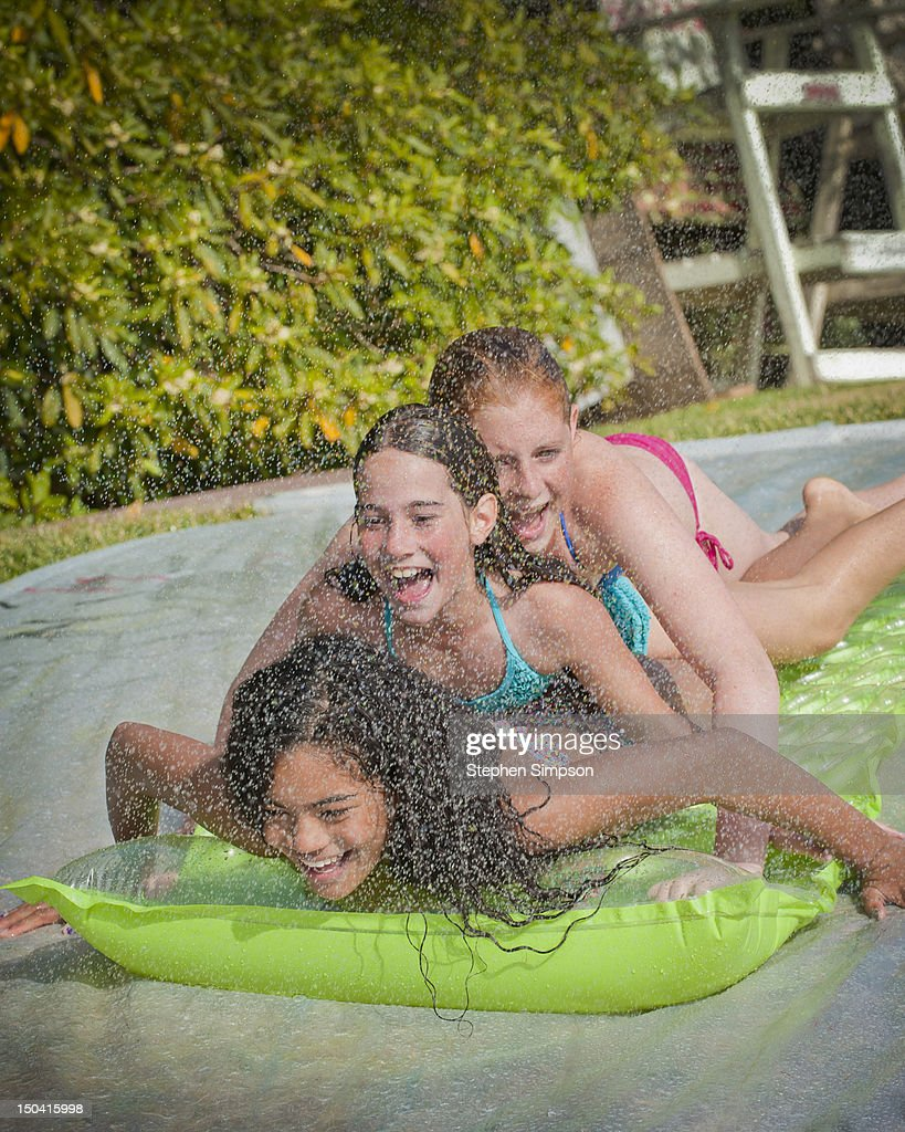 backyard water fight between 11yearold girls stock photo getty