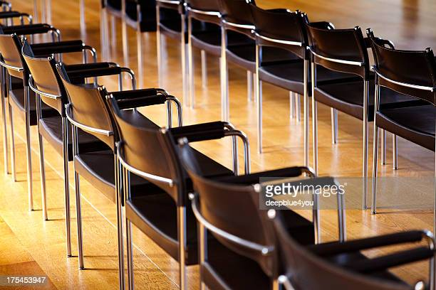 bacl chairs in a row in a Conference room