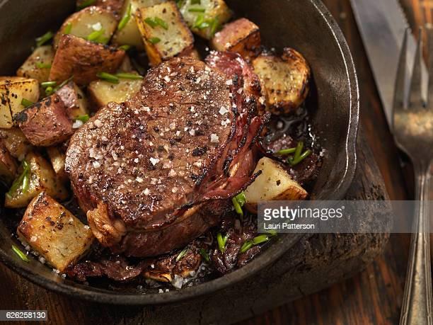 Bacon Wrapped Steak Fillets Sautéed in Garlic Butter