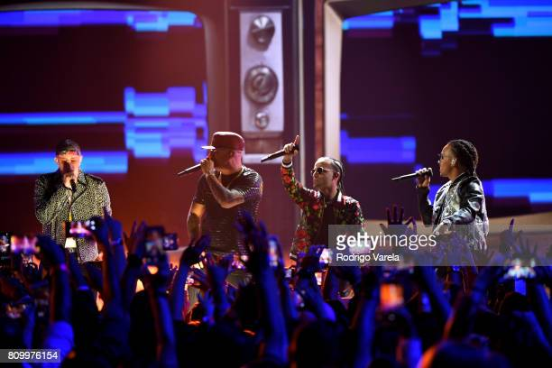 Bad Bunny Wisin Arcangel and Ozuna perform on stage during Univision's 'Premios Juventud' 2017 Celebrates The Hottest Musical Artists And Young...