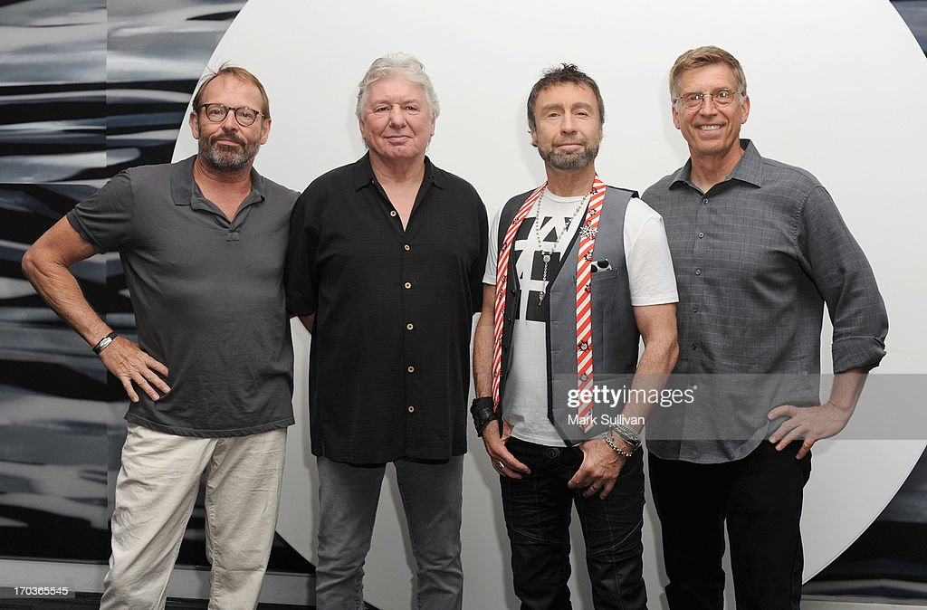 Bad Company members drummer Simon Kirke, guitarist/songwriter Mick Ralphs and singer/songwriter Paul Rodgers pose in the museum with GRAMMY Museum executive director Bob Santelli (R) before An Evening With Bad Company at The GRAMMY Museum on June 11, 2013 in Los Angeles, California.