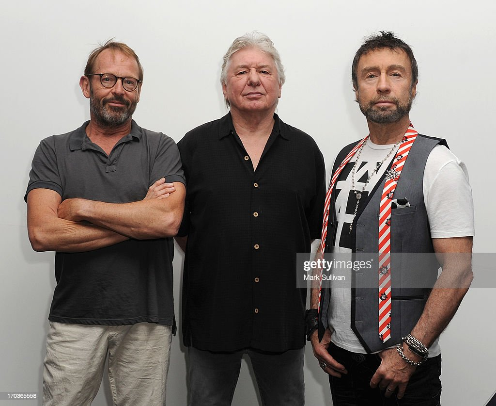 Bad Company members drummer Simon Kirke, guitarist/songwriter Mick Ralphs and singer/songwriter Paul Rodgers pose in the museum before An Evening With Bad Company at The GRAMMY Museum on June 11, 2013 in Los Angeles, California.