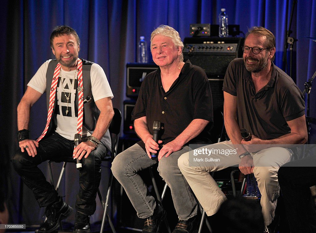 Bad Company members Singer/songwriter Paul Rodgers, guitarist/songwriter Mick Ralphs and drummer Simon Kirke onstage during An Evening With Bad Company at The GRAMMY Museum on June 11, 2013 in Los Angeles, California.