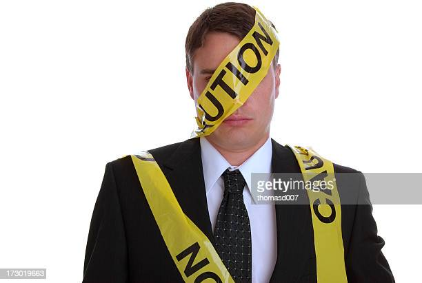 Bad employee covered in yellow caution tape