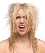 Portrait of a preety young girl with messed up hair isolated on white background
