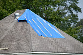 Damaged roof with bad shingles