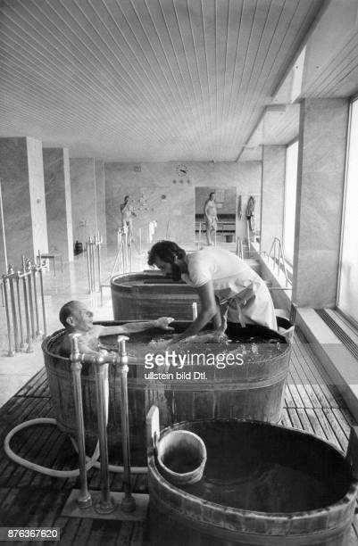 Bad Soden medical treatments in the thermal spa patient in a bath tub during underwater massage