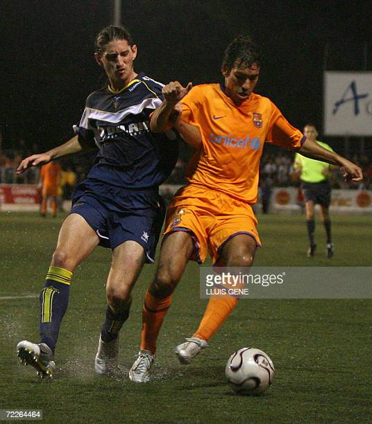 Barcelona's Dutch Gio van Bronkhorst vies with CF Badalona's Cazorla during their King's Cup football match at the Camp del Centenari stadium in...