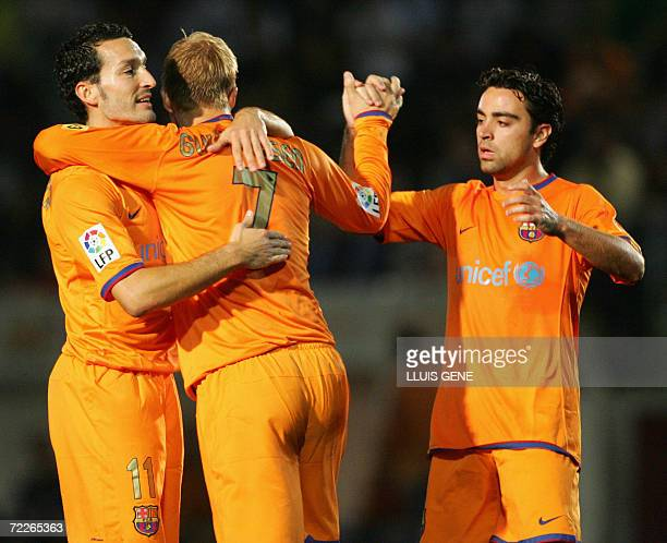 Barcelona's Icelandic Gudjhonsen Italian Zambrotta and Xavi celebrate after scoring against CF Badalona during their King's Cup football match at...