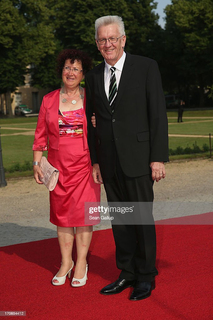 Baden-Wuerttemberg Governor <a gi-track='captionPersonalityLinkClicked' href=/galleries/search?phrase=Winfried+Kretschmann&family=editorial&specificpeople=7227897 ng-click='$event.stopPropagation()'>Winfried Kretschmann</a> and his wife Gerlinde attend the dinner given in honour of U.S. President Barack Obama at the Orangerie of Schloss Charlottenburg palace on June 19, 2013 in Berlin, Germany. Obama is visiting Berlin for the first time during his presidency and his speech at the Brandenburg Gate is to be the highlight. Obama will be speaking close to the 50th anniversary of the historic speech by then U.S. President John F. Kennedy in Berlin in 1963, during which he proclaimed the famous sentence: 'Ich bin ein Berliner.'
