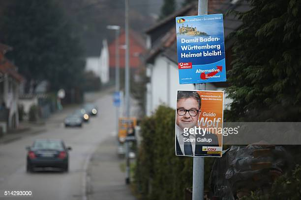 BadenWuerttemberg state election campaign posters for the Alternative fuer Deutschland political party and the German Christian Democrats hang from a...