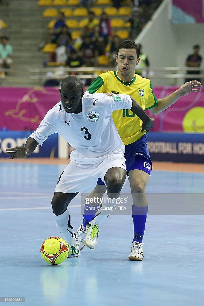 Bader Hasan #3 of Libya contests the ball with Fernandinho #10 of Brazil during the FIFA Futsal World Cup, Group C match between Brazil and Libya at Korat Chatchai Hall on November 4, 2012 in Nakhon Ratchasima, Thailand.