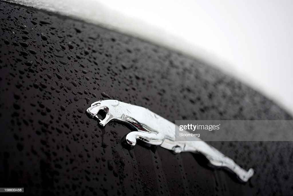 A badge sits on the body of a Jaguar XJ automobile outside a Jaguar Land Rover auto dealership in Moscow, Russia, on Thursday, Dec. 27, 2012. Tata Motors Ltd.'s Jaguar Land Rover luxury unit signed a letter of intent with Saudi Arabia's government to study the feasibility of setting up a factory to build its models locally. Photographer: Andrey Rudakov/Bloomberg via Getty Images