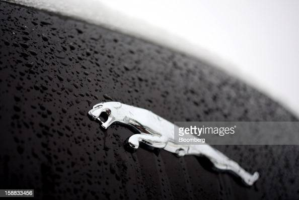 A badge sits on the body of a Jaguar XJ automobile outside a Jaguar Land Rover auto dealership in Moscow Russia on Thursday Dec 27 2012 Tata Motors...