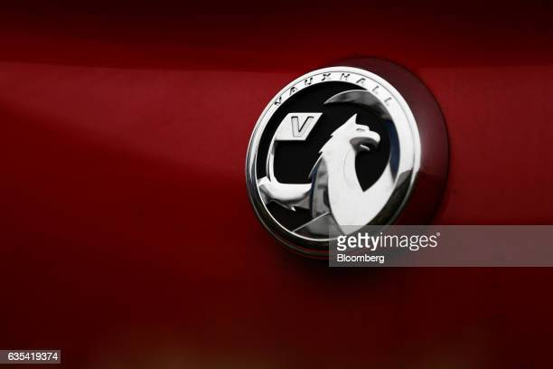 A badge sits on the boot of a Vauxhall Astra for sale at a showroom opposite the Vauxhall plant operated by General Motors Co in Luton UK on...