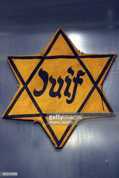 A badge use to identified Jews prisoners in the Nazi's concentration camps is displayed at the Holocaust museum in Jerusalem 20 January 2005 On...
