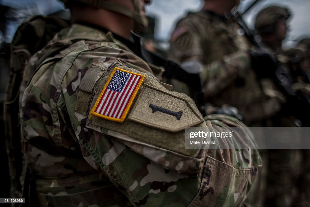 A badge with flag of USA is placed on the sleeve of an U.S. soldier of the 2nd Cavalry Regiment of the US Army as he arrived with others at Czech army barracks on May 27, 2016 in Prague, Czech Republic. About 420 U.S. soldiers with 225 army vehicles are travelling in the 'Dragoon Ride II' convoy from Germany to Estonia where they will participate in the Saber Strike 16 exercise in the Baltic region. With this exercise, NATO shows cohesiveness and readiness of the involved countries to collective defense and future operations in Europe.