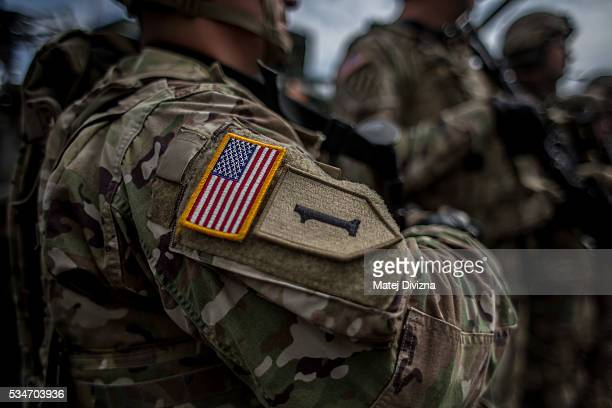 A badge with flag of USA is placed on the sleeve of an US soldier of the 2nd Cavalry Regiment of the US Army as he arrived with others at Czech army...