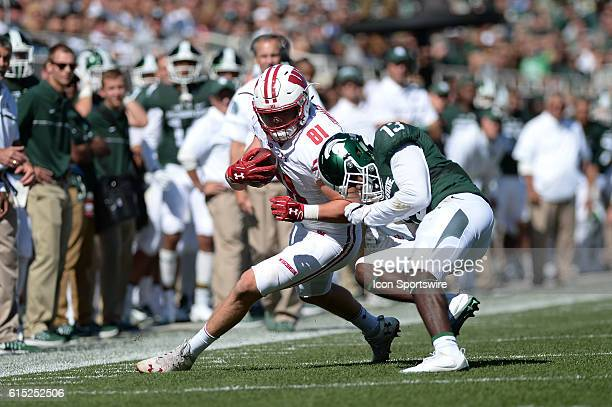 Badgers tight end Troy Fumagalli is tackled by Spartans cornerback Vayante Copeland in the red zone during a Big Ten Conference NCAA football game...