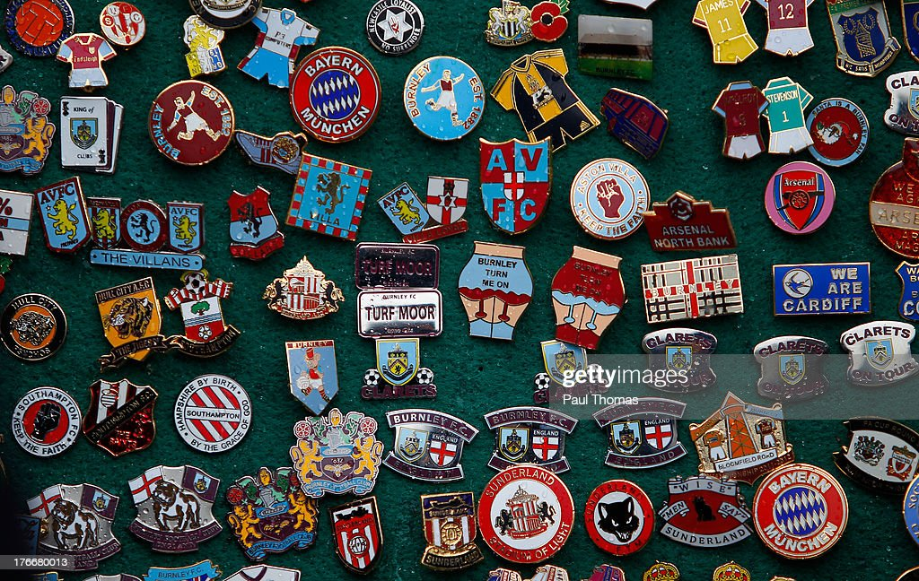 Badges are displayed for sale outside the ground before the Sky Bet Championship match between Burnley and Yeovil Town at Turf Moor on August 17, 2013 in Burnley, England