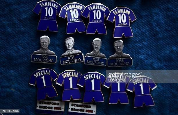 Badges featuring Chelsea's former Portuguese manager Jose Mourinho are on sale before the English Premier League football match between Chelsea and...