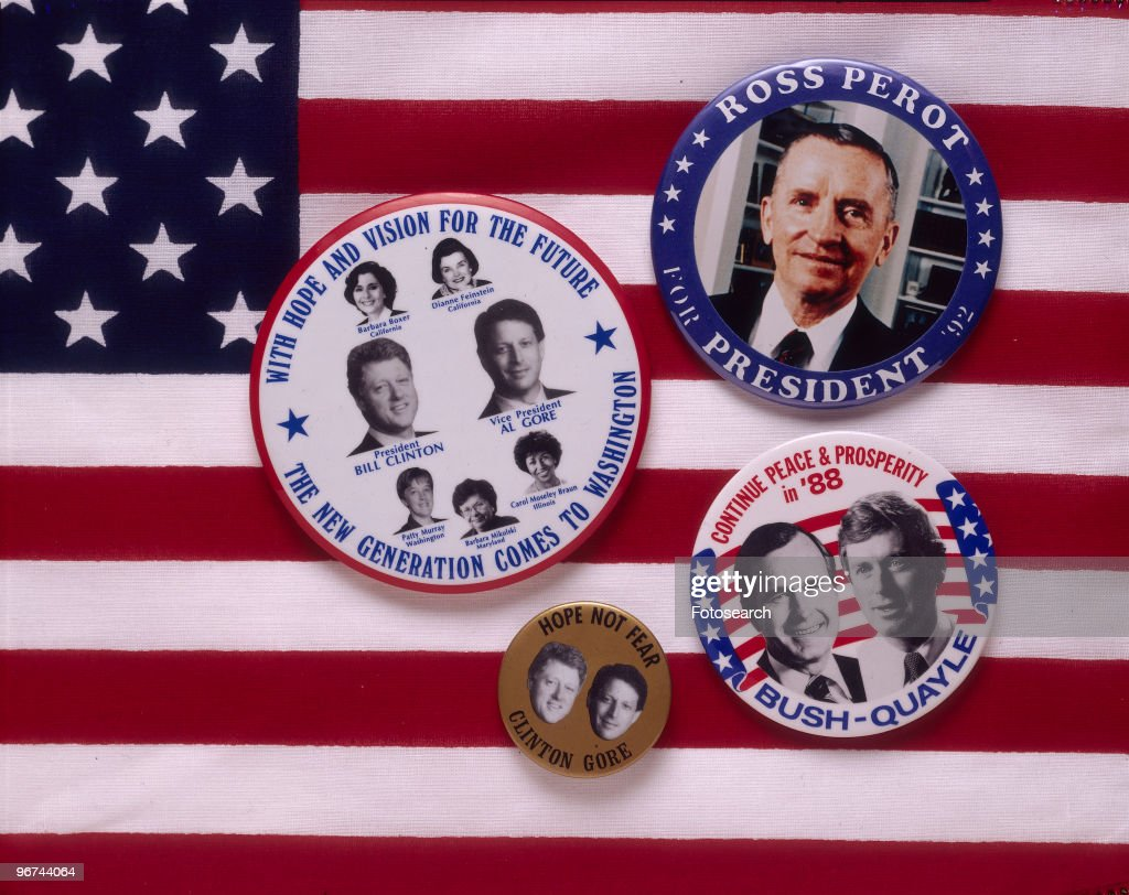 Badges for the 1988 ial Election, the badges - set on a background of the Stars and Stripes, feature the candidates Bill Clinton and Al Gore (Democratic), George Bush and Dan Quayle (Republican), and Ross Perot. USA, 1988. (Photo by Fotosearch/Getty Images).