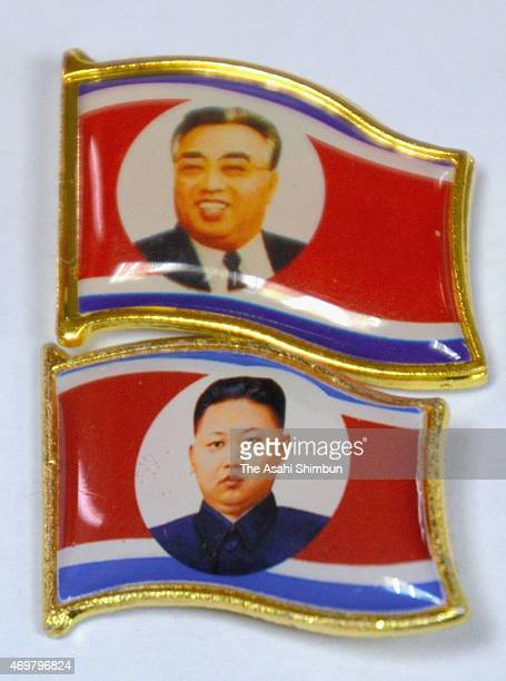 Badges of Kim JungEun along with that of Kim Ilsung on April 15 2015 in Dandong China It is unknown whether North Korean government distrubute or...