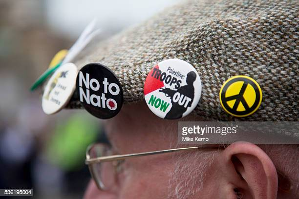 Badges on a flat cap Protest in central London to mark 10 years of the conflict in Afghanistan Musicians actors filmmakers and MPs are joining...