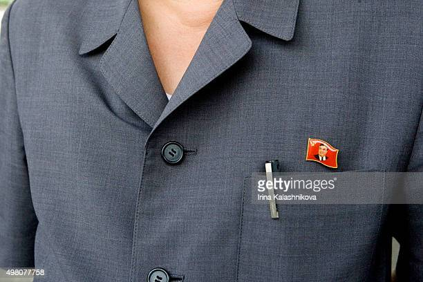 Badges supporting Kim IlSung worn by North Koreans