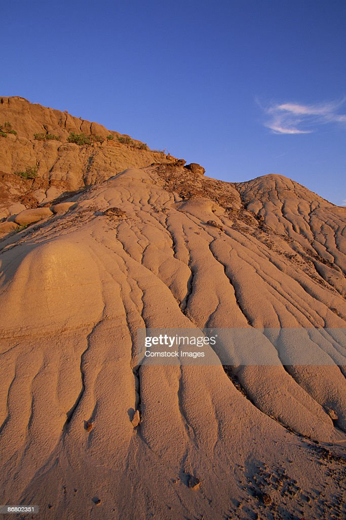 Badlands and moon at sunset : Stock Photo