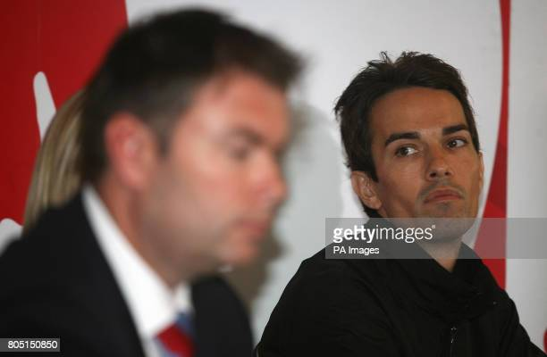 Badminton England Chief Executive Adrian Christy and player Nathan Robertson talk to the media during a press conference at the National Badminton...