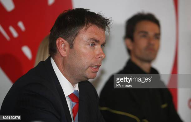 Badminton England Chief Executive Adrian Christy speaks to the media watched by player Nathan Robertson during a press conference at the National...