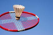 Badminton racket with Danish flag and shuttlecock sky blue.