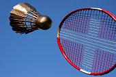 Badminton racket with Danish flag and golden shuttlecock sky blue.