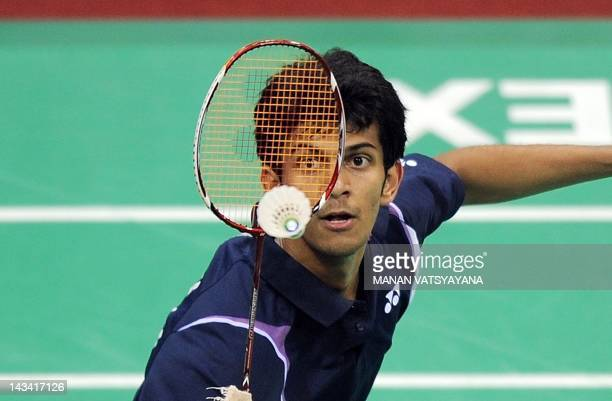 Badminton player Ajay Jayaram of India returns a shot against Lee Chong Wei of Malaysia during the YonexSunrise India Open 2012 at the Siri Fort...