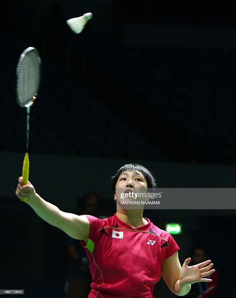 Badminton player <a gi-track='captionPersonalityLinkClicked' href=/galleries/search?phrase=Akane+Yamaguchi&family=editorial&specificpeople=11382505 ng-click='$event.stopPropagation()'>Akane Yamaguchi</a> of Japan plays a shot to Sung Ji Hyun of Korea during the semi final women's singles match at the BWF Destination Dubai World Superseries Finals at Hamdan Sports Complex in Dubai on December 20, 2014.