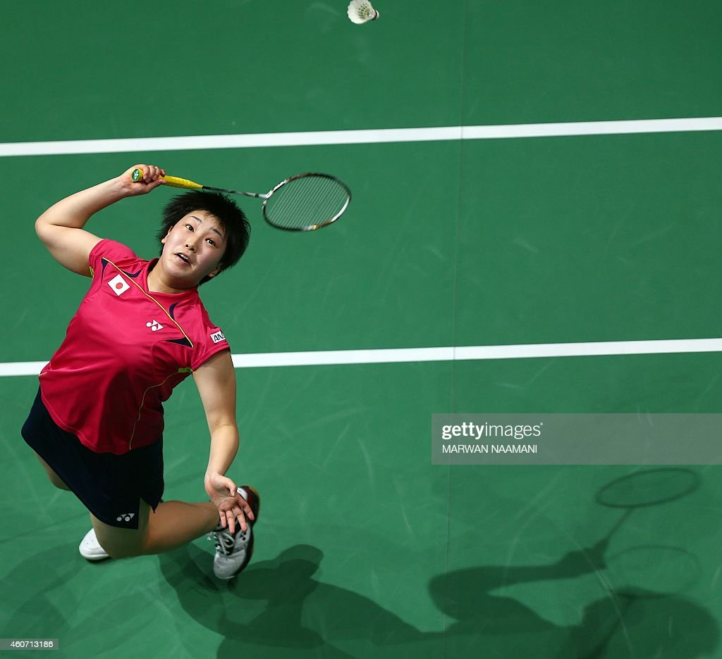 Badminton player Akane Yamaguchi of Japan plays a shot to Sung Ji