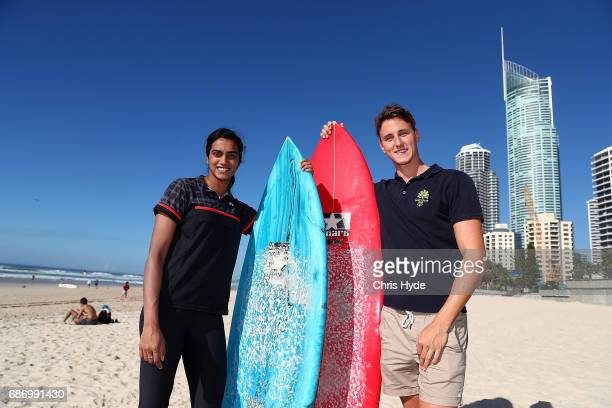 Badminton player PV Sindhu of India poses with Olympic swimmer Cameron McEvoy during a Sudirman Cup media opportunity at Surfers Paradise Beach on...