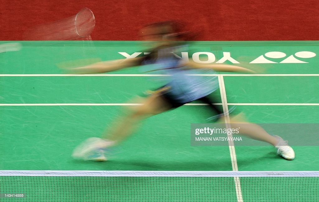 Badminton player Shixian Wang of China plays against Ai Goto of Japan during the Yonex-Sunrise India Open 2012 at the Siri Fort Sports Complex in New Delhi on April 26, 2012. Wang beat Goto 21-19, 21-19.