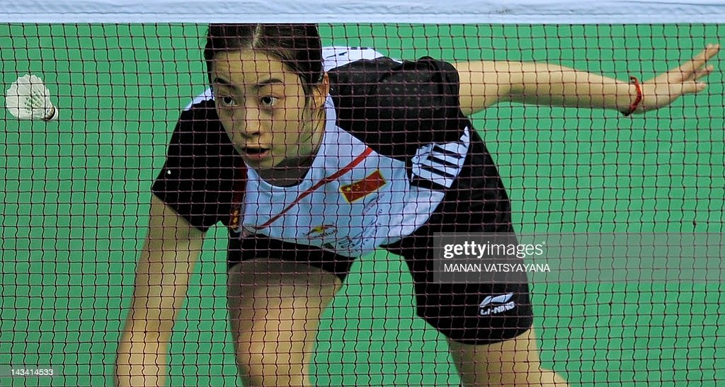 Badminton player Shixian Wang of China returns a shot against Ai Goto of Japan during the Yonex-Sunrise India Open 2012 at the Siri Fort Sports Complex in New Delhi on April 26, 2012. Wang beat Goto 21-19, 21-19.