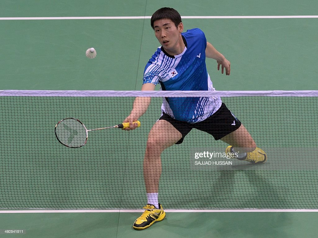 Badminton player Son Wan Ho of SKorea plays a return to opponent