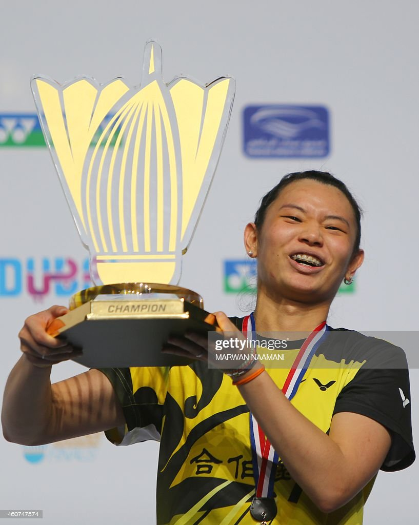 Badminton player Tai Tzu Ying of Taiwan poses with her trophy