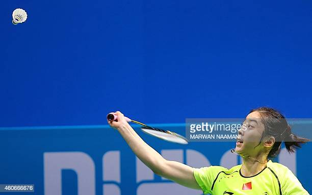 Badminton player Wang Shixian of China plays a shot to Sung Ji Hyun of Korea during the women's singles match at the BWF Destination Dubai World...