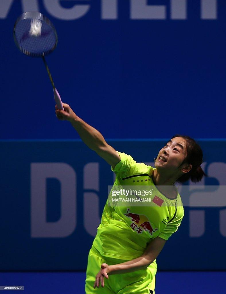 Badminton player Wang Shixian of China plays a shot to Sung Ji Hyun of Korea during the women's singles match at the BWF Destination Dubai World...
