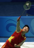Badminton player Yu Yang of China hits a shot during a training session at the Beijing University of Technology Gymnasium in Beijing on August 07...